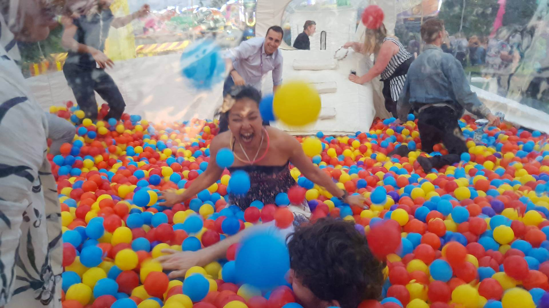 people playing in ball pit