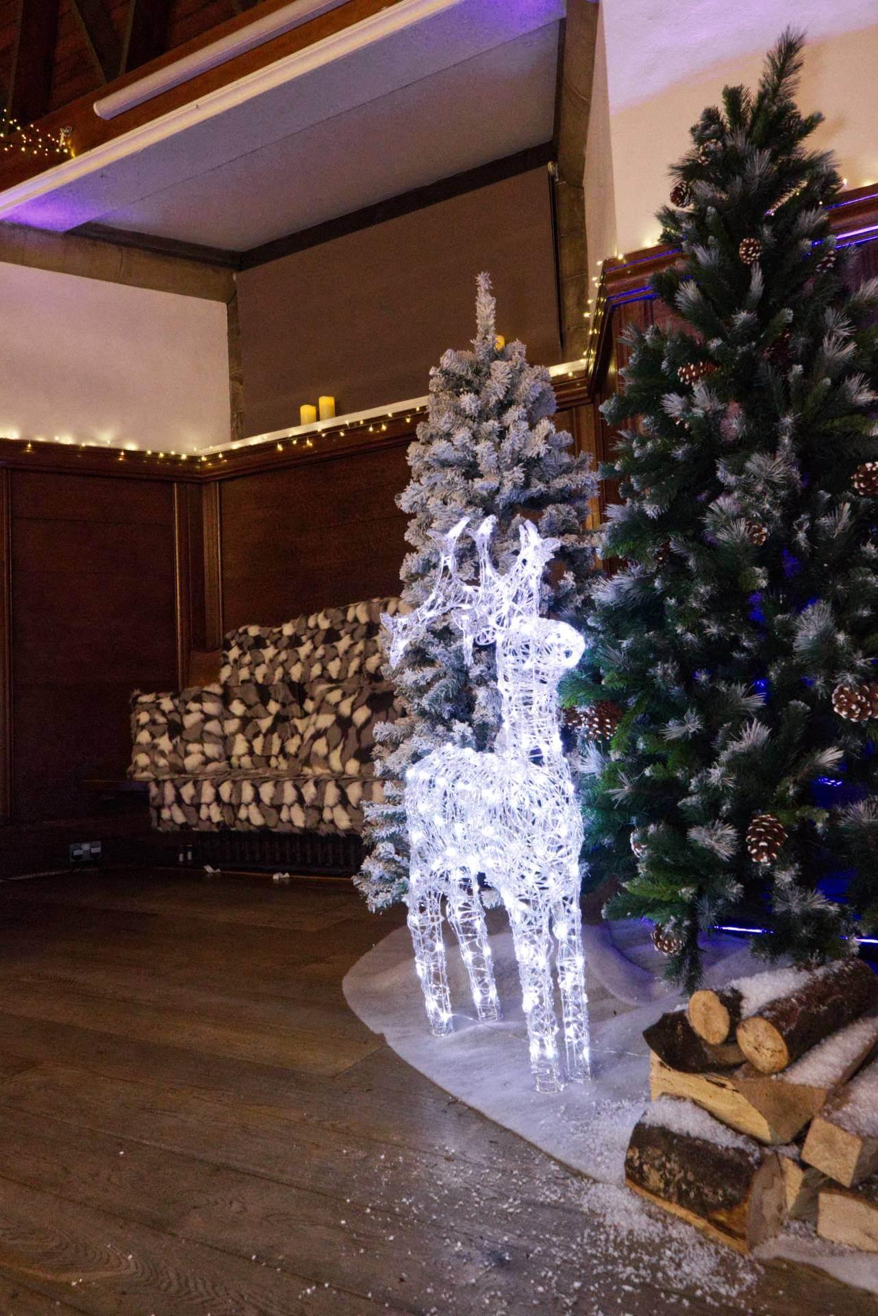 deer lights beside christmas tree